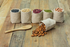 Different kinds of beans in sacks bag Stock Photos
