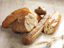 Different kinds of bread. Different types of bread on a wooden surface stock photos