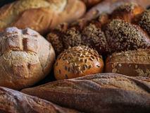 Different kinds of bread on background. Royalty Free Stock Photos
