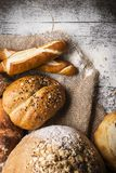 Breads on wooden table Royalty Free Stock Images