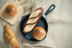 Different kinds of bread in the kitchen royalty free stock images