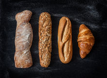 Different kinds of bread rolls on black from above Royalty Free Stock Photography
