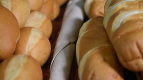 Different kinds of bread and bread rolls on board. Kitchen or bakery poster design. stock footage