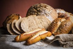 Breads on wooden table Royalty Free Stock Image