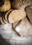 Breads on wooden table Royalty Free Stock Photo