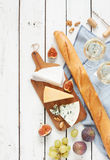 Different kinds of cheeses baguette, wine, figs and grapes stock photos