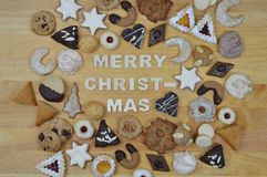 Christmas cookies and MERRY CHRISTMAS Stock Images