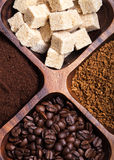 Different kinds of coffee on wooden plate Royalty Free Stock Images