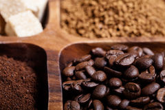 Different kinds of coffee on wooden plate. Selective focus Stock Photos