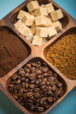 Different kinds of coffee on wooden plate. Toned Royalty Free Stock Image