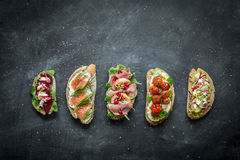 Different kinds of colorful sandwiches on black royalty free stock photos