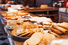 Different kinds of cookies on plates in restaurant Royalty Free Stock Image