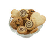Different kinds of cookies in a vase. Different kinds of cookies in a glass vase, over white Royalty Free Stock Photos