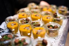 Different kinds of fingerfood being served at a party stock photos