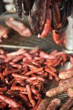 Different kinds of fresh spanish sausages hanging in bunches on the marketplace. Soft focus.6 stock images