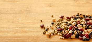 Different kinds of Grains. Five grains put on wooden background Stock Images