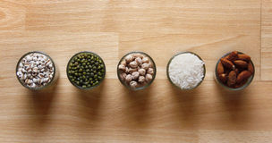Different kinds of Grains. Lentil, peas in dish on wooden table Stock Image