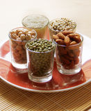 Different kinds of Grains. Lentil, peas in dish on wooden table Stock Photo
