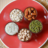Different kinds of Grains. Lentil, peas in dish on wooden table Stock Photography