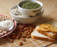 Different kinds of Grains. Lentil, peas in dish on wooden table Royalty Free Stock Photos