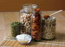 Different kinds of Grains. Lentil, peas in dish on wooden table Royalty Free Stock Image