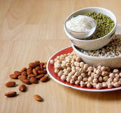 Different kinds of Grains. Lentil, peas in dish on wooden table Stock Photos