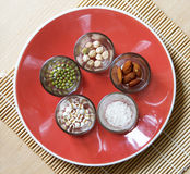 Different kinds of Grains. Lentil, peas in dish on wooden table Royalty Free Stock Photography