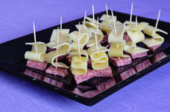 Different kinds of ham  and cheese gauda arranged ready to be served for a party Stock Images