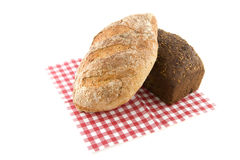 Different kinds of healthy bread. On checkered napkin stock image
