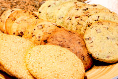Different kinds of homemade cookies on plates close up Royalty Free Stock Photos