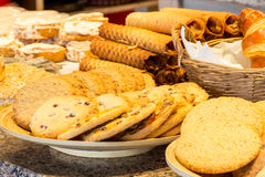 Different kinds of homemade cookies on plates Stock Photography