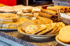 Different kinds of homemade cookies on plates Royalty Free Stock Photography