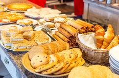 Different kinds of homemade cookies on plates Stock Images