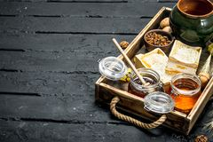Different kinds of honey on wooden tray stock photos