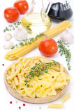 Different kinds of Italian pasta, fresh tomatoes Stock Photo