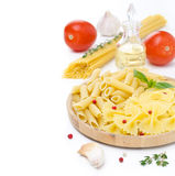 Different kinds of Italian pasta, fresh tomatoes, olive oil and Stock Image