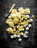Different kinds of Italian raw pasta. On dark rustic background royalty free stock photography