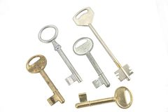 Different kinds of keys. Different kinds of metal keys lying on white bakcground Royalty Free Stock Images