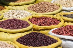 Different kinds of legumes beans in bulk bags on the market in Yangon, Myanmar. Full, trade, wholesale, green, peas, chickpea, lentils, kidney, broad, sack royalty free stock images