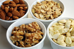 Different kinds of nuts like almonds, peanuts, etc. Isolated on white background Royalty Free Stock Photo