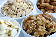 Different kinds of nuts like almonds, peanuts, etc. Isolated on white background Royalty Free Stock Photos