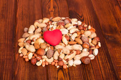 Different kinds of nuts, peeled, whole against background dark wood. Stock Photo