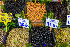 Different kinds of olives on sale. Different kinds of black and green olives on sale at street market in Istanbul, Turkey Royalty Free Stock Images