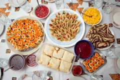 Different kinds of pancakes stuffed with various fillings and de Stock Photo