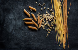 Different kinds of pasta on black chalkboard Stock Image