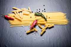 Different kinds of pasta, red chili pepper, rosemary, sea salt a Stock Image