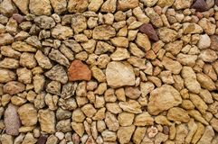 Different kinds of pebbles lying on the beach royalty free stock image