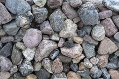 Different kinds of pebbles lying on the beach stock photos
