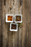 Different kinds of pepper in bowls Royalty Free Stock Photography