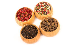 Different kinds of peppercorn beans  isolated Royalty Free Stock Photos